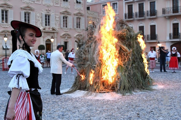 Princess Charlene and Prince Albert of Monaco watched the traditional celebrations of St. John's Day procession (Fête de la Saint-Jean) at Palace Square in Monaco