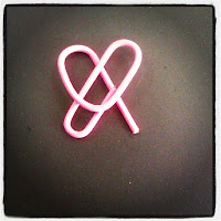 heart-shaped pink paperclip