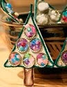 http://www.manualidadesplus.com/2010/11/adornos-para-navidad-con-reciclaje.html