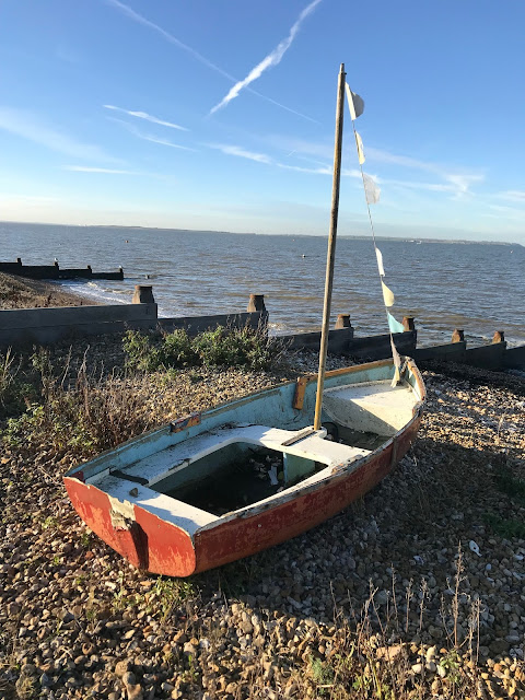 A red boat on the beach, Whitstable, Kent
