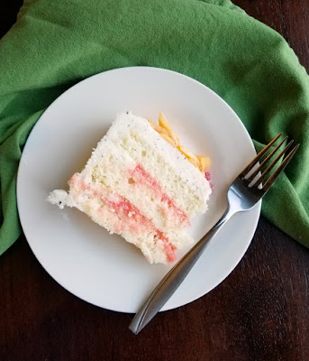 slice of layer cake and fork on plate
