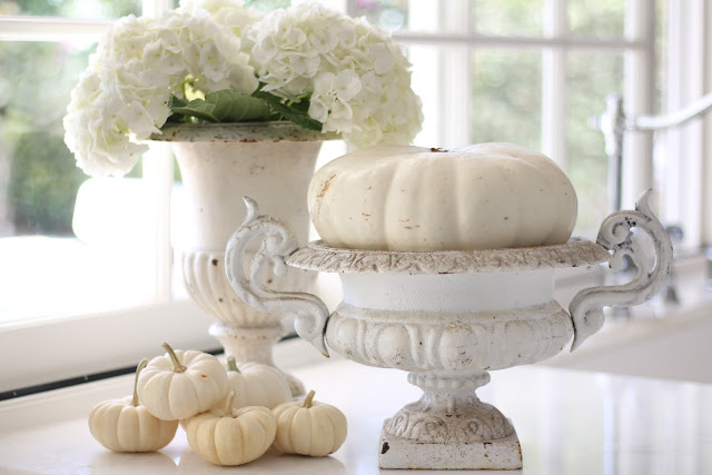neutral fall decor white pumpkins vintage crusty urns