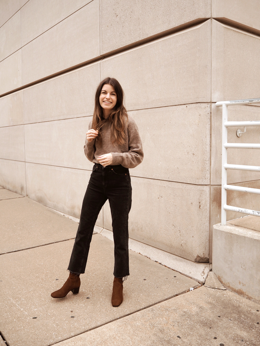21 Black Cropped Flare Jeans to Wear This Winter — neutral sweater, raw hem jeans, and brown suede ankle boots