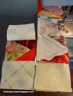 Two columns of three red and cream squares each are sewn together to in the penultimate step of making a Variable Star quilt block.