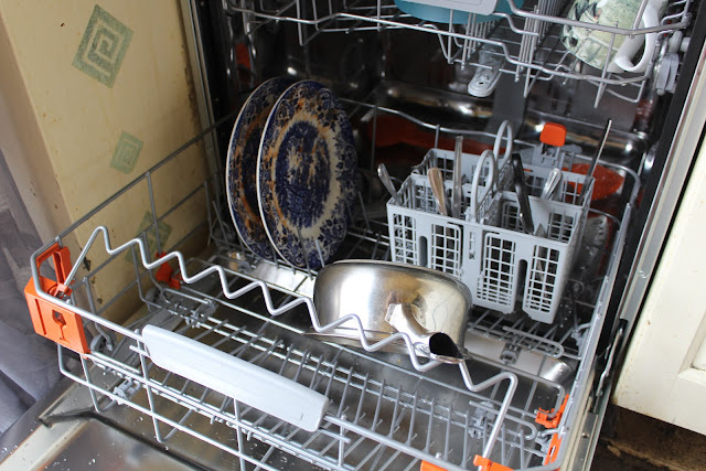 loading saucepans into a dishwasher