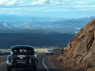 1953 Jaguar XK120 FHC coming down Pikes Peak