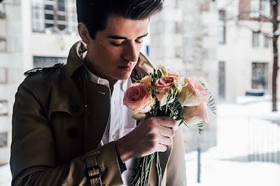 man holding flowers bouquet