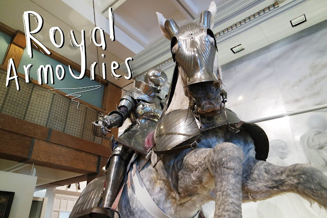 A knight on a stuffed grey horse, both wearing armour