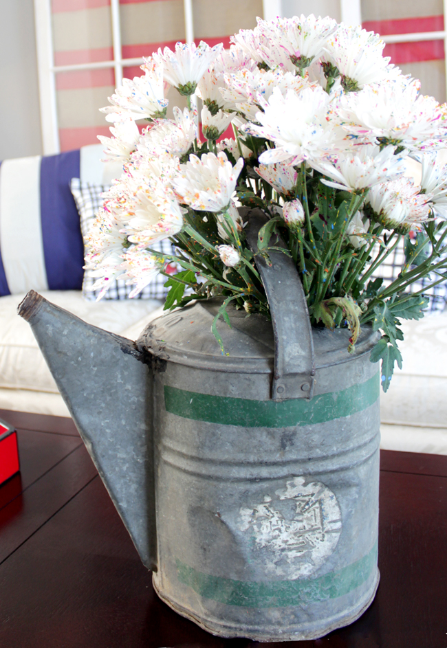 white fourth of july flowers inside watering can