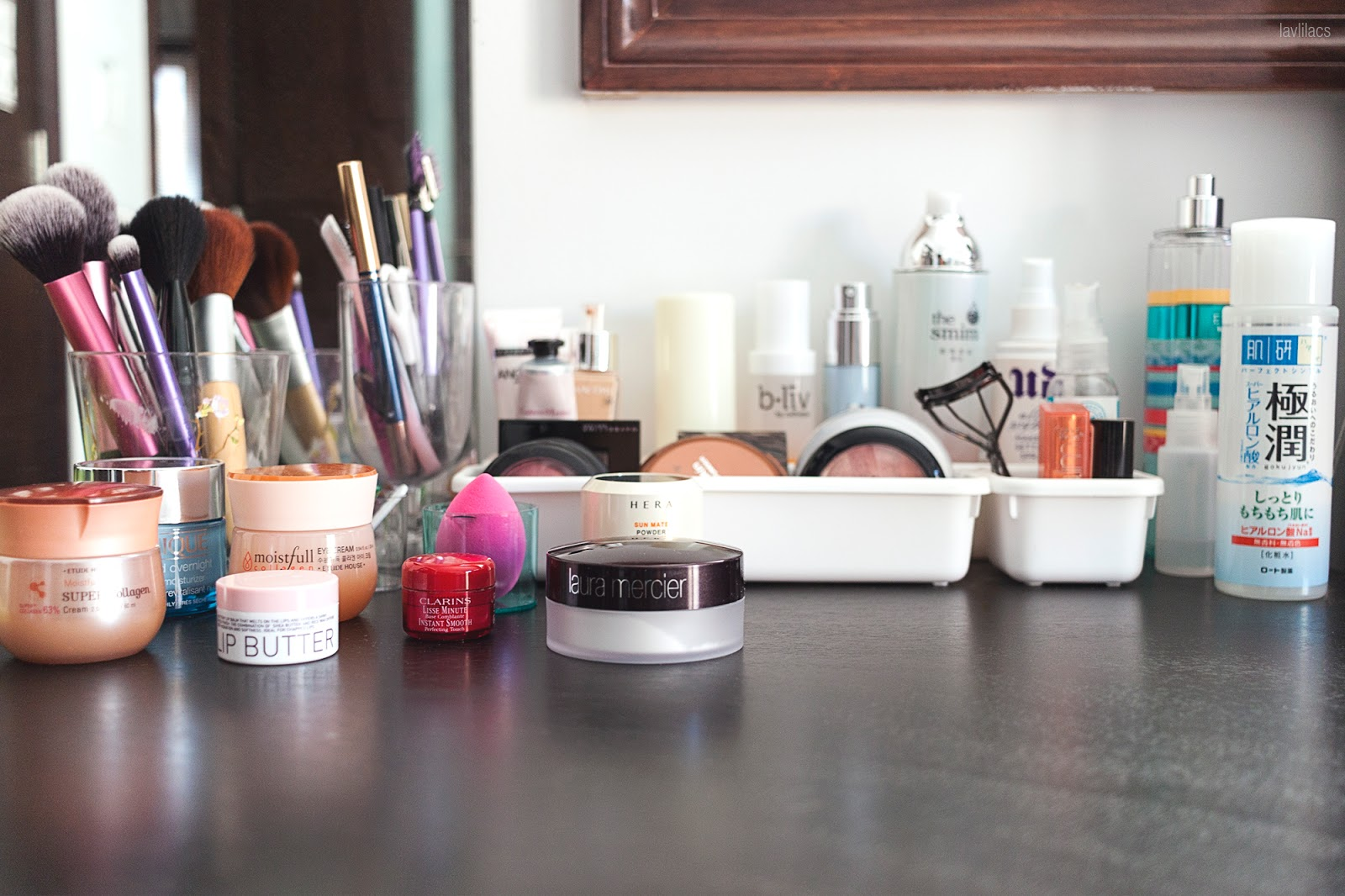 Daily makeup skincare products on top of bedside table
