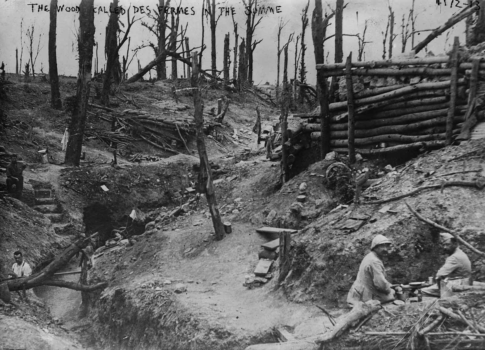 Soldiers sit in the trenches of the wood called Des Fermes in the Somme.