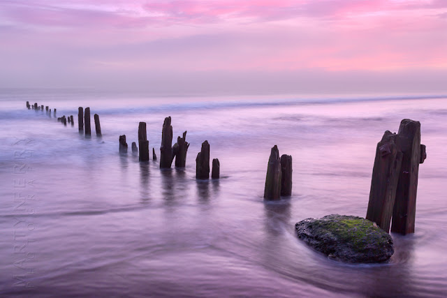 Beach groynes at Sandsend in North Yorkshire at sunrise by Martyn Ferry Photography