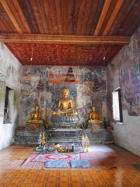 Buddha statue and shrine inside Wat Pa Huak