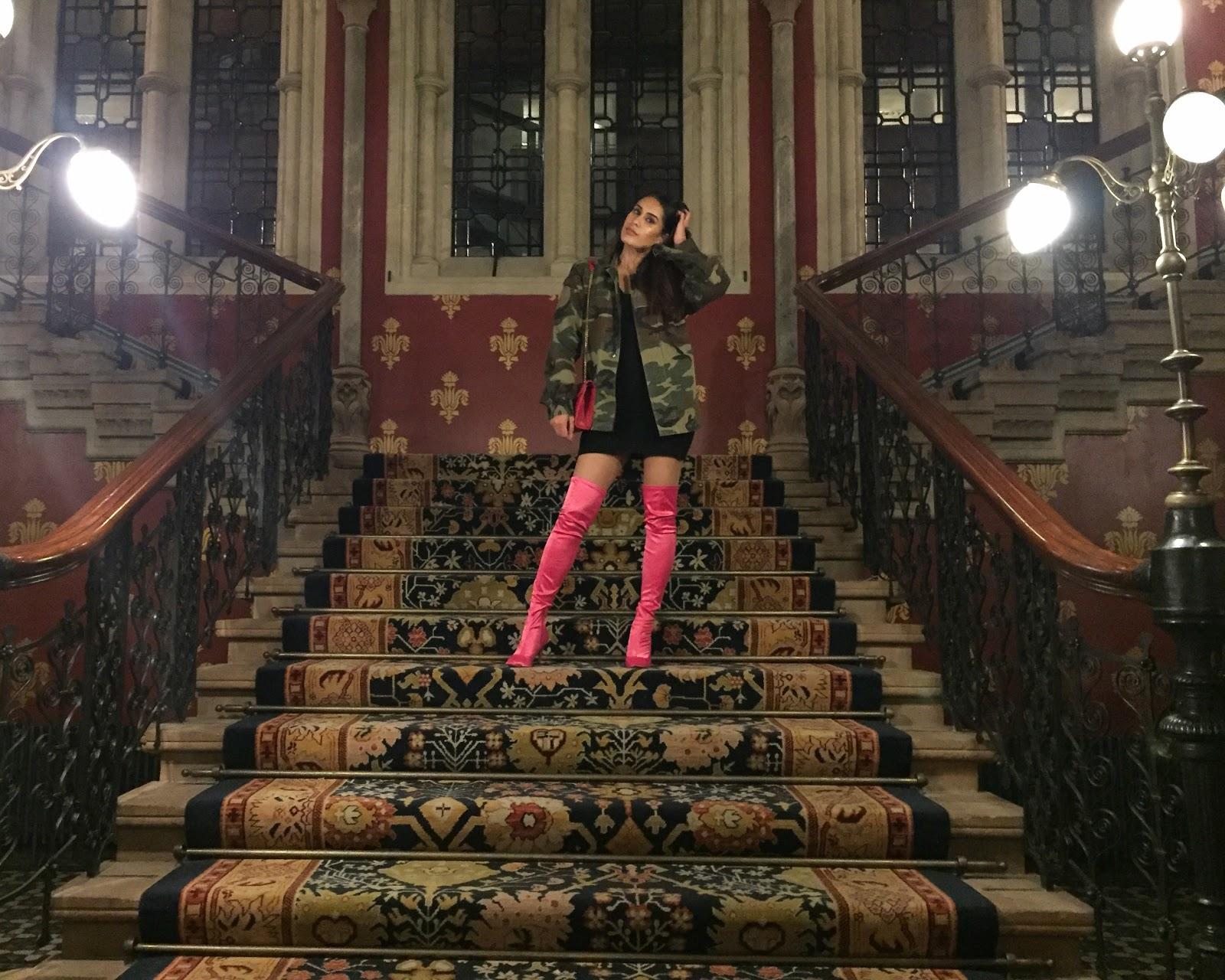 Fashion blogger Reena Rai on the Spice Girls staircase at St Pancras Renaissance hotel