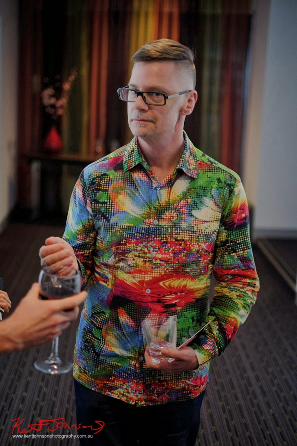 Robert in digital print shirt at Memetico by Sam Rey, Gallery Mercure Sydney. Photography by Kent Johnson.