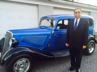 the author's father beside one of his cars