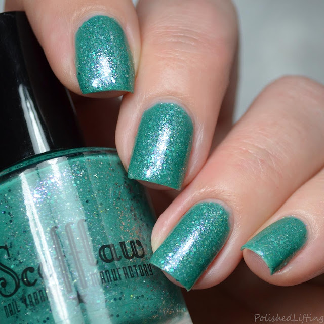 teal crelly nail polish with shimmer