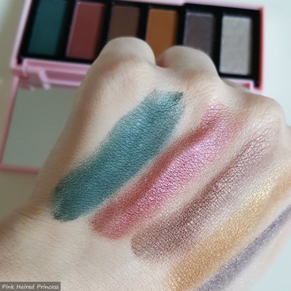 asos out out eyeshadow palette green and pink swatches on hand
