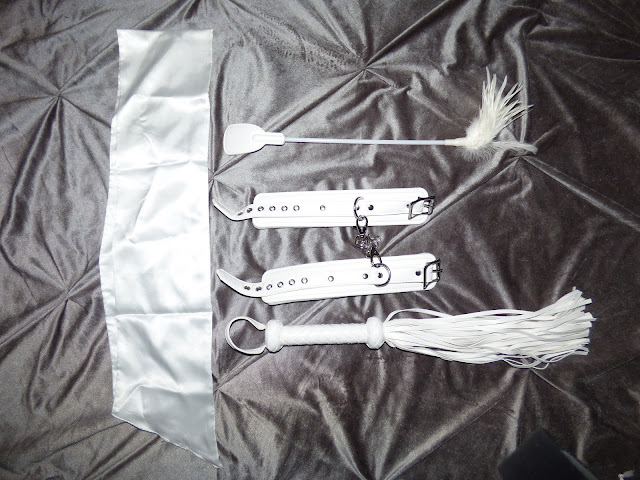 Dalliance satin blindfold, soft whip, feather tickler, and hand cuffs