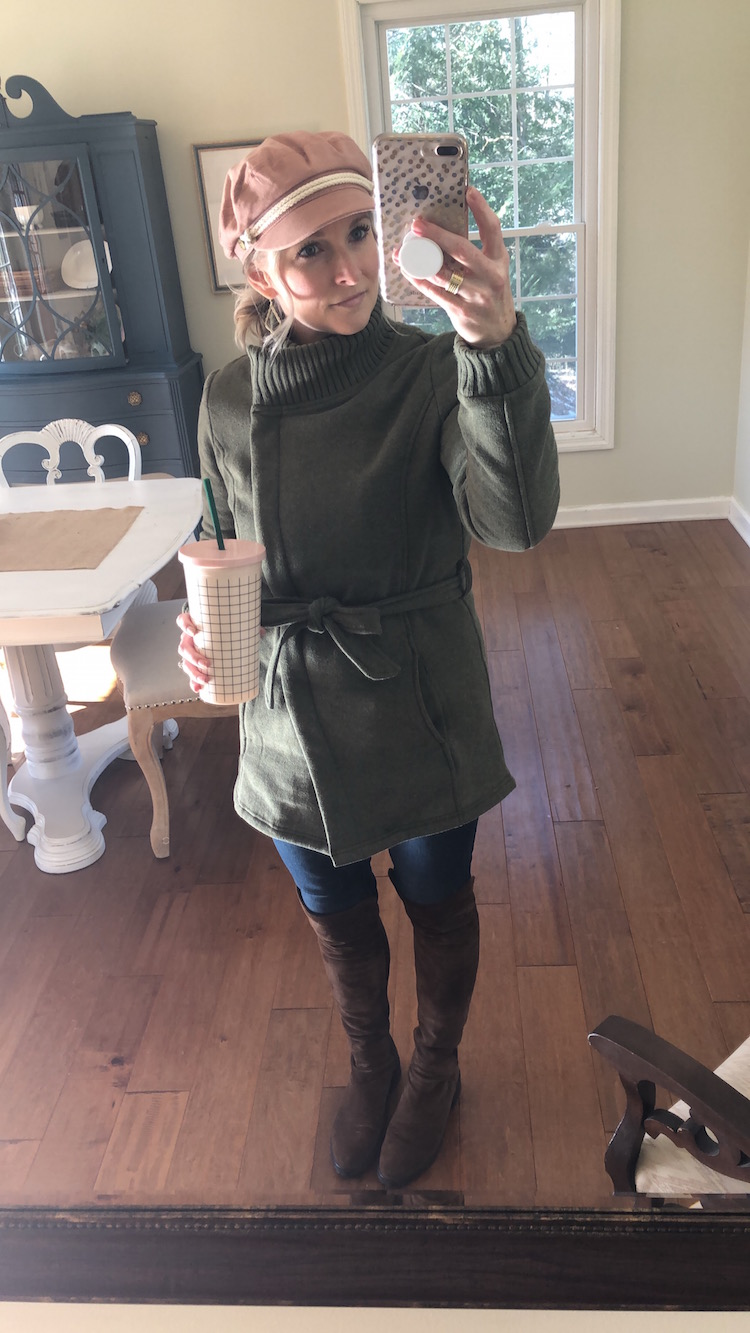 olive jacket with pink hat and over the knee boots