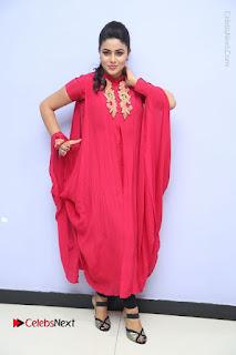Actress Poorna Latest Stills in Red Dress at Rakshasi First Look Launch  0349.JPG