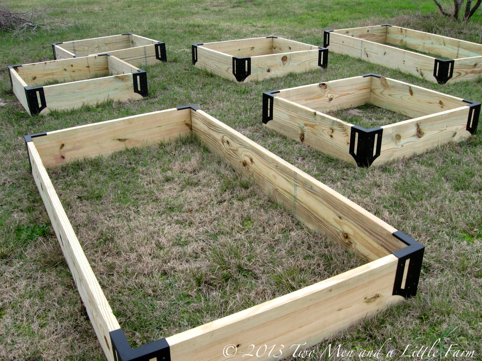 Two men and a little farm raised garden beds step one for Attractive raised vegetable beds