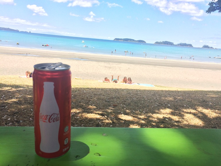 Coca cola, on ice, at the beach because SUMMER