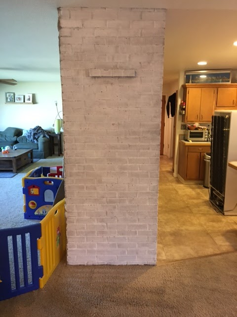 Whitewashing a brick wall - 2nd coat