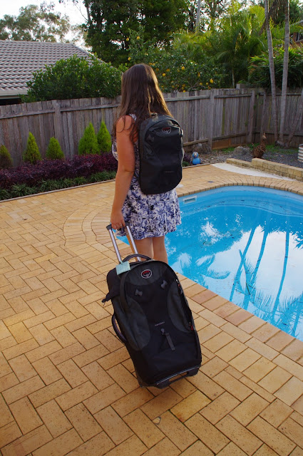Girl with Osprey Meridian 75 Luggage as suitcase