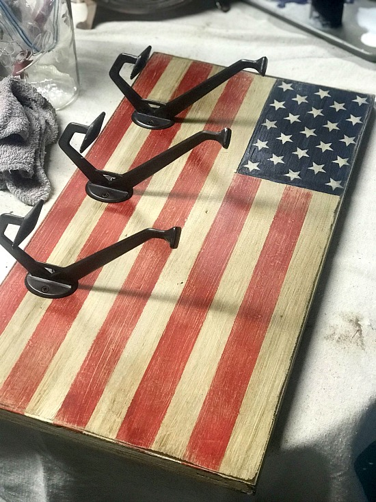 Giant hooks on American flag coat rack