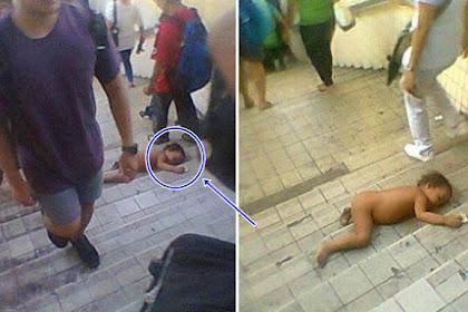 Sungguh miris !! Bocah Kelaparan Terbaring Tanpa Busana di Jalanan Dibiarkan Saja.. mohon disebarkan ya