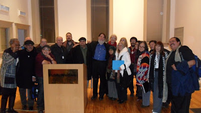 Group photo of poets at reading protesting AZ law SB 1070, in 2011 in DC