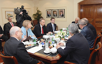 Middle East peace mediators including Tony Blair attend a meeting with Palestinian and Israeli negotiators in Amman on Jan. 3, 2012.
