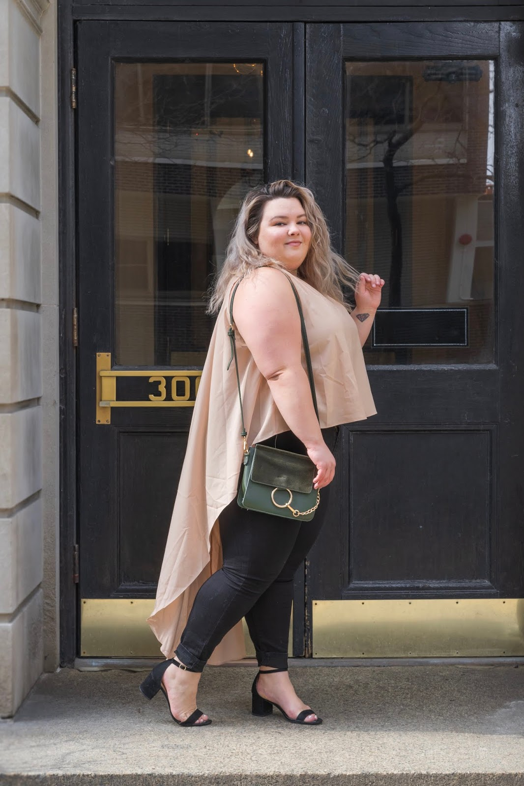 Chicago Plus Size Petite Fashion Blogger, YouTuber, and model Natalie Craig, of Natalie in the City, review's Fashion Nova's hi-lo tops and jeans.