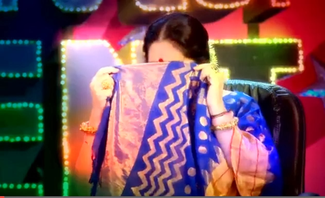 Kiran Kher covering her face with the pallu of sari (saree) while a performance in India's Got Talent