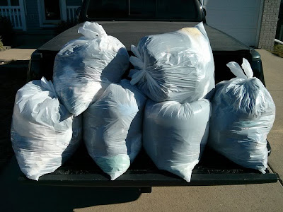 six bags of T-shirts going to Goodwill