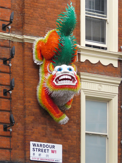 Chinese dragon on a wall, Wardour Street, Soho, London