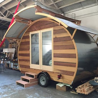 The Interior Has An Atwood Two Burner Stove A Sink With Gravity Fed Faucet Four LED Lights And Maple Wood Kitchen Counter Cabinets