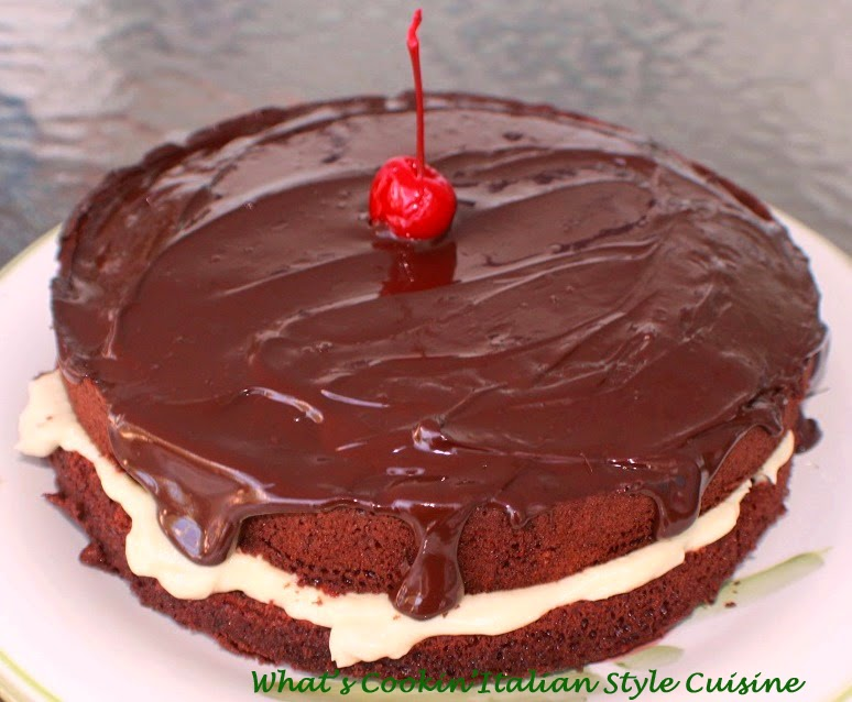 Chocolate Torte  cake with a fudge ganache on top a cherry delicious cream filled chocolate cake on a plate for a birthday party. The cake is light in texture and made from scratch
