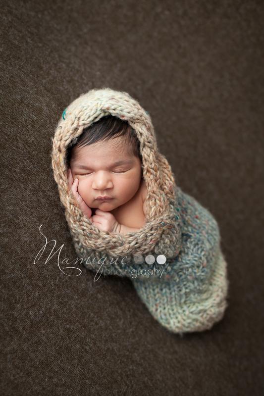 Newborn infant in cocoon