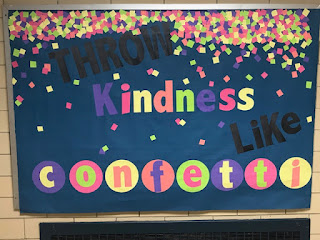 This is a picture of a bulletin board that promotes spreading kindness like confetti.