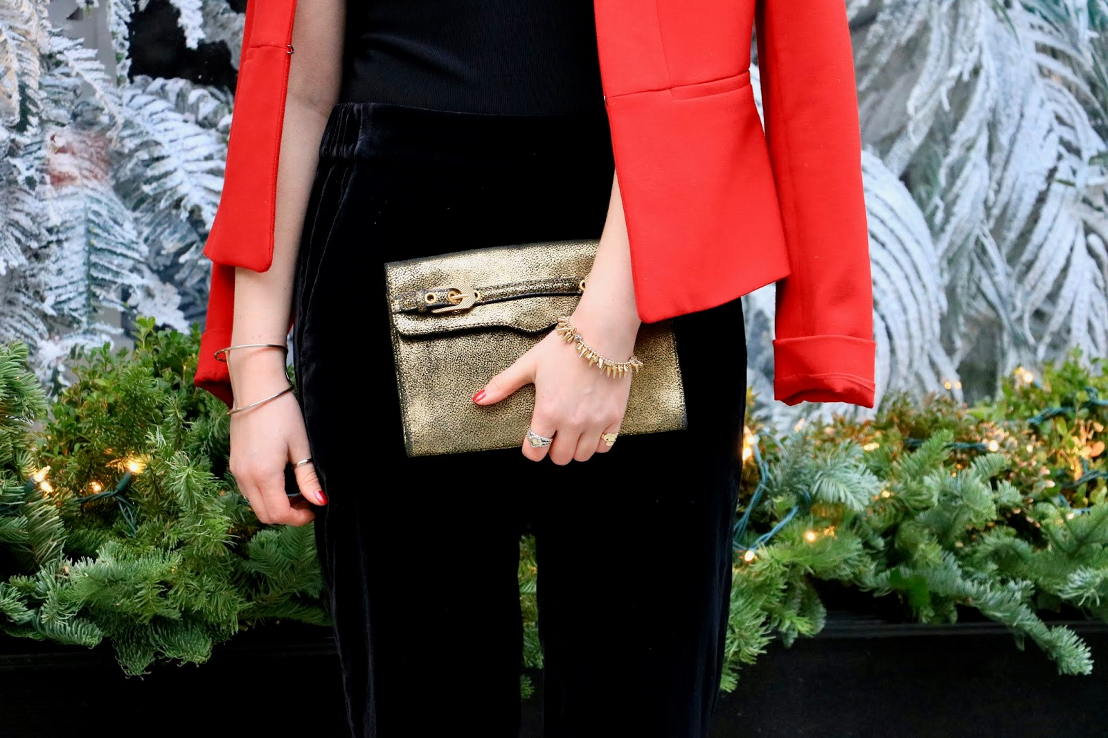 Nyc fashion blogger Kathleen Harper wearing a Rebecca Minkoff gold clutch