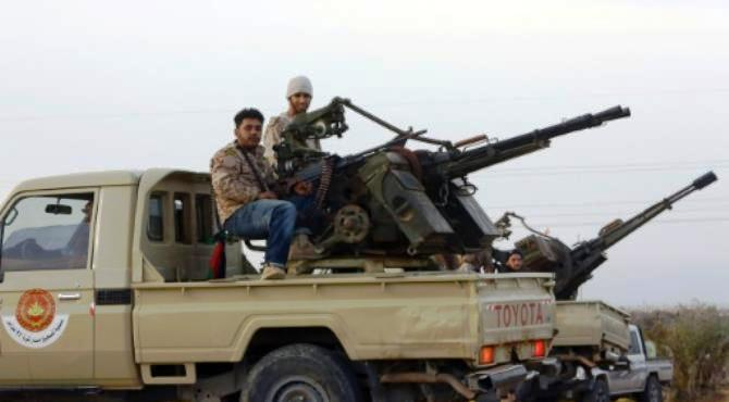 Members of a brigade loyal to Libya Dawn, an alliance of Islamist-backed militias, sit on a pick up truck mounted with a machine gun on March 15, 2015 in Libya's coastal city of Sirte. By Mahmud Turkia (AFP/File)  Tripoli (AFP) - Key dates since the Islamic State group (IS) moved into Libya in 2014 amid the chaos that followed the ouster of Moamer Kadhafi in 2011.