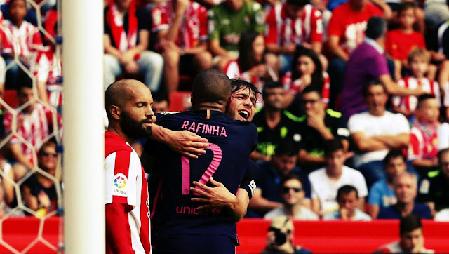 Barca football players Sergi Roberto and Rafinha Celebrating after scoring against Sporting Gijon