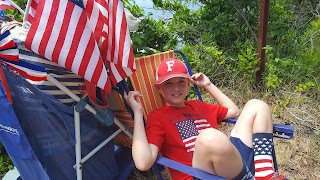 celebrating July 4th in patriotic gear with flags