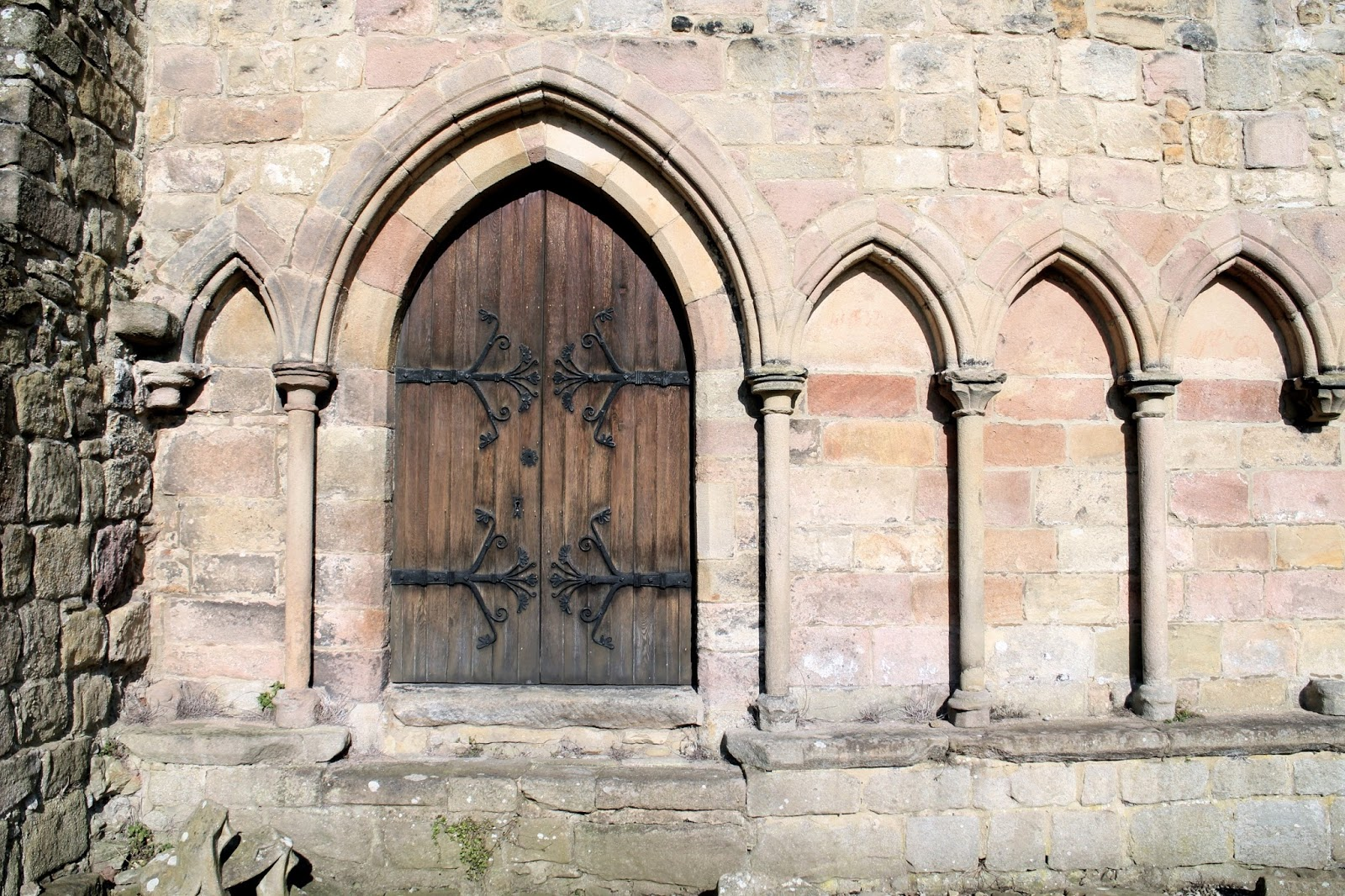 A wooden door on the outside of the Bolton Priory