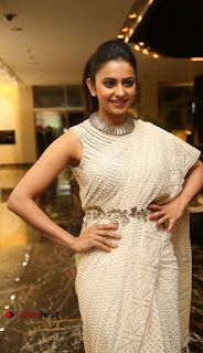 Actress Rakul Preet Singh Stills in White Dress at Winner Pre Release Function  0018.jpg