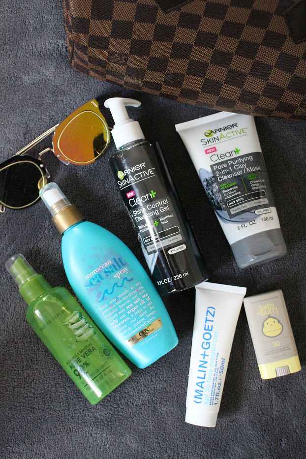 summer skincare tips, summer haircare tips, OGX Moroccan Sea Salt Spray, Nature Republic Aloe Vera Soothing Gel Mist, Garnier Skinactive Clean Pore Purifying 2-in-1 Clay Cleanser/Mask, Garnier Skinactive Clean Shine Control Cleansing Gel, (Malin+Goetz) SPF 30 Face Moisturizer Broad Spectrum, Sun Bum Baby Bum SPF 30 Broad Spectrum Stick
