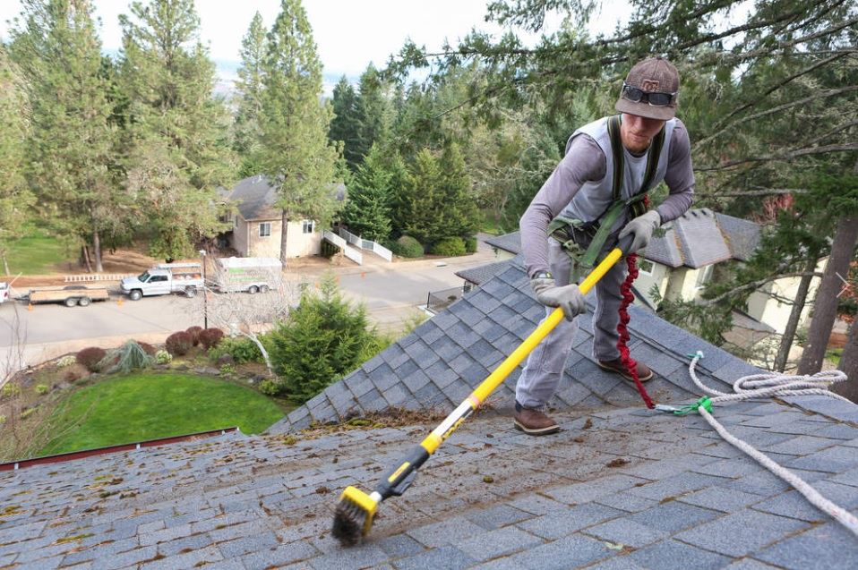 Good Jeffrey Hausmann, Pressure Supervisor At Custom Window Cleaning And  Property Maintenance, Scrapes The Moss Off Of A Roof In Eugene. For Many  Window Cleaners ...