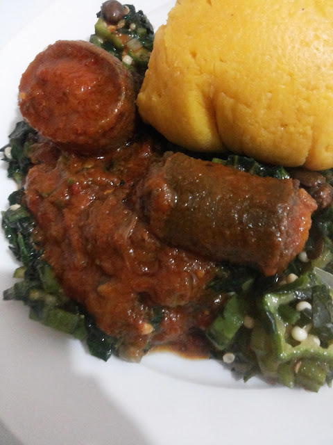 ugu okro soup served with corn flour fufu